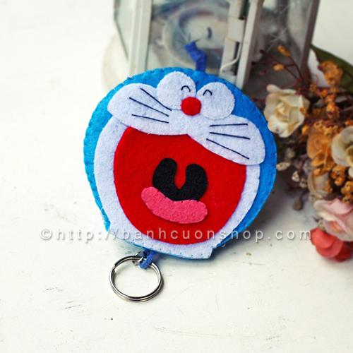 BK08 Bao khóa Doraemon béo ú. Bạn là fan hâm mộ của chú mèo máy Doraemon thì chắc chắn phải sở hữu ngay chiếc bao khóa này rồi! Chiếc bao khóa mang đầy kỉ niệm tuổi thơ sẽ làm bạn luôn tươi trẻ, vui vẻ.